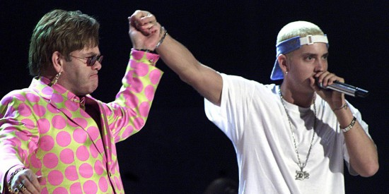 LOS ANGELES, UNITED STATES:  Elton John (L) joins rap musician Eminem (R) during their much anticipated performance at the 43rd Annual Grammy Awards 21 February 2001 at the Staples Center in Los Angeles. The controversial rapper Eminem won three Grammys despite anger over his lyrics, which critics revile as misogynist, anti-gay and violent.  AFP PHOTO/Hector MATA (Photo credit should read HECTOR MATA/AFP/Getty Images)