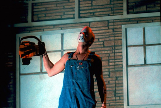 380673 04: Rapper Eminem dons a hockey mask and chainsaw onstage at his performance in New Jersey Meadowlands Arena October 19, 2000 in Secaucas, NJ. (Photo by George DeSota/Newsmakers)
