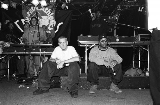"NEW YORK - MARCH 1999:  Rappers Eminem, left, and Royce Da 5'9"", right, with unidentified rappers and DJs on turntables in background, perform at Tramps in March 1999 in New York City, New York. (Photo by Catherine McGann/Getty Images)"