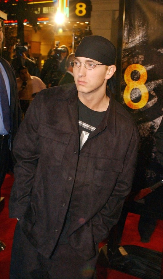 "LOS ANGELES, CA - NOVEMBER 6:  Rap singer Eminem walks past photographers at the premiere of his film ""8 Mile,"" 06 November 2002, in the Westwood section of Los Angeles. AP PHOTO/RENE MACURA  (Photo credit should read RENE MACURA/AFP/Getty Images)"