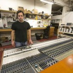 Vintage King Audio technician Jeff Spatafora looks over a refurbished Neve 8078 audio mixer at its warehouse in Ferndale. Vintage King specializes in providing vintage equipment to studios across the country. / Jarrad Henderson/Detroit Free Press