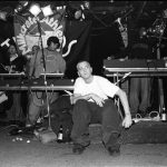NEW YORK - MARCH 1999: Rapper Eminem, seated, and unidentified rappers and DJs on turntables in background, perform at Tramps in March 1999 in New York City, New York. (Photo by Catherine McGann/Getty Images)