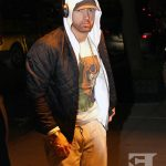 Rapper Eminem returns back to his hotel after spending some time in the recording studio in New York City. Real name Marshall Mathers is set to release his new album 'Revival' and will be performing on SNL on November 18th, 2017.