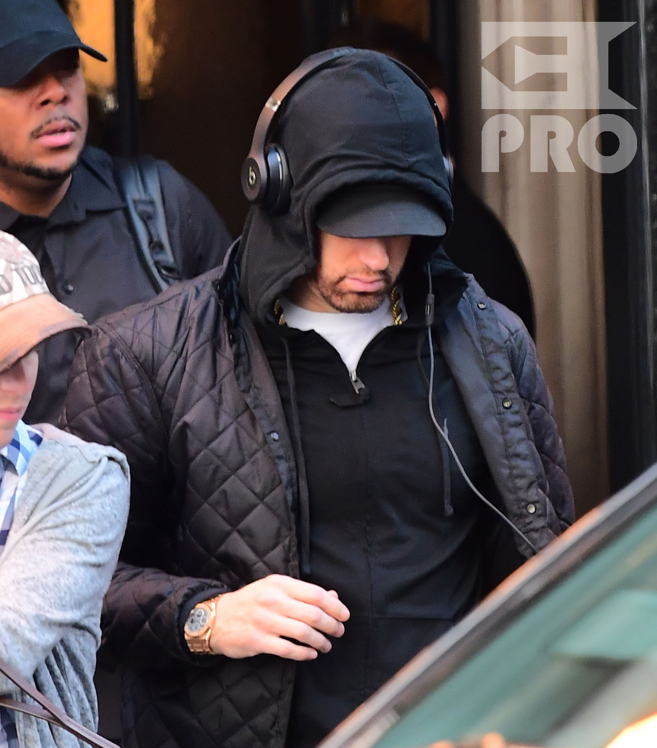 EXCLUSIVE: Eminem is notorious for his low-key lifestyle, so seeing him in public in NYC on Thursday was extremely rare. The rapper went incognito in a jacket, hoodie and baseball cap as he left a hotel in Manhattan surrounded by security guards. His face could be seen under his cap, and he appeared to be extremely tired, as he headed to an early morning rehearsal for Saturday Night Live.
