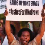 Фраза «Hands Up, Don't Shoot» («Руки вверх, не стреляйте») стала слоганом движения «Black Lives Matter» (прим. Eminem.Pro: «Жизни черных имеют значение») после роковой стрельбы в Майкла Брауна белым полицейским 9 августа 2014 года. Фраза происходит из заявлений о том, что руки Майкла Брауна были в воздухе, согласно требованиям офицеров, когда они застрелили его.