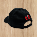 "Limited Edition Dad Hat from Eminem's 2018 Irving Plaza performance. Black dad hat with the Revival flag logo embroidered on the front and ""New York"" embroidered on the back."