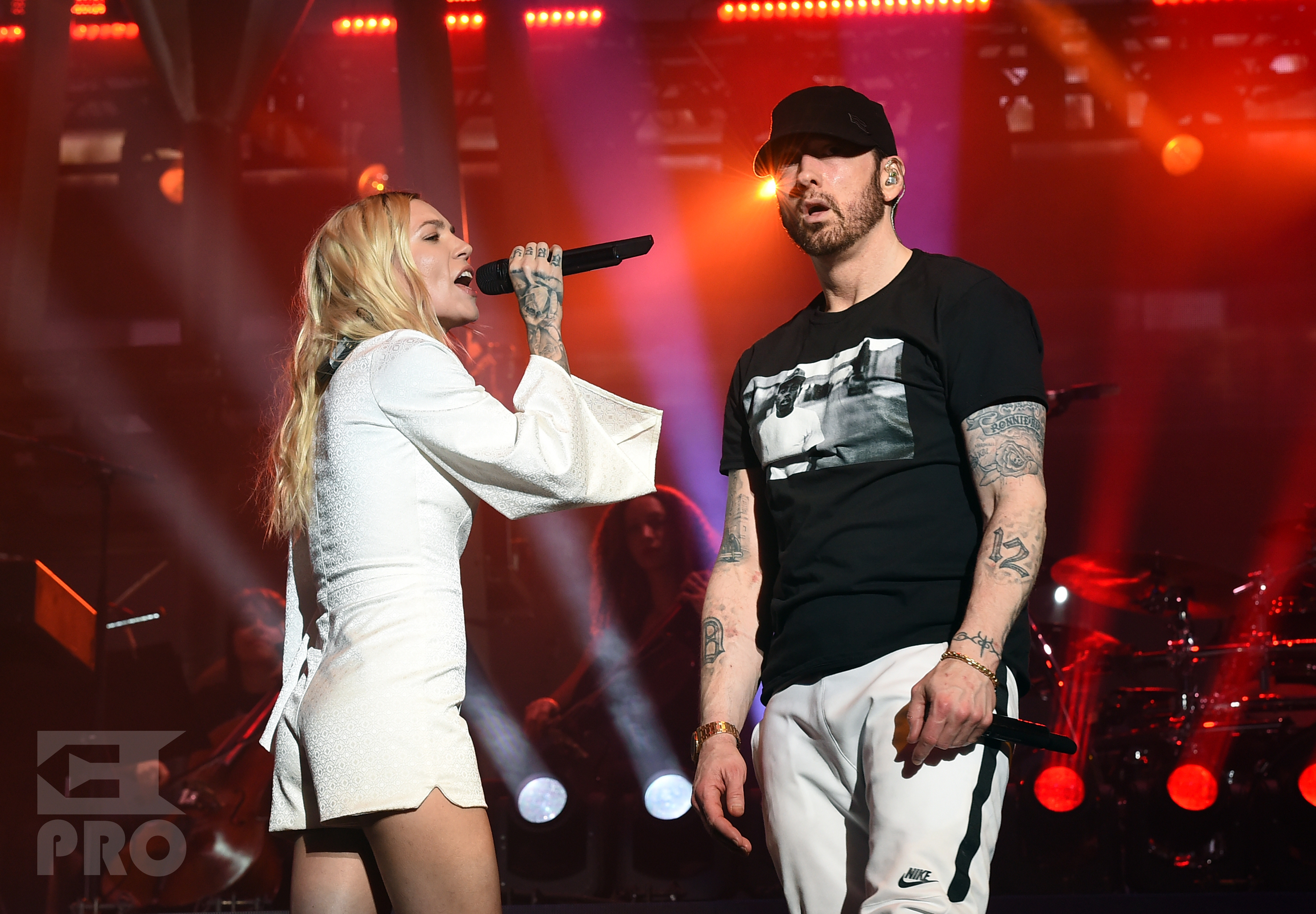 INDIO, CA - APRIL 15: Skylar Grey (L) and Eminem perform onstage during the 2018 Coachella Valley Music and Arts Festival Weekend 1 at the Empire Polo Field on April 15, 2018 in Indio, California. (Photo by Kevin Winter/Getty Images for Coachella)