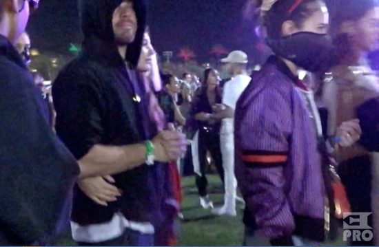 EXCLUSIVE: Leonardo DiCaprio gets many hugs and a kiss from his new girlfriend as she showed much affection moments before the Eminem performance at Coachella. Camila Morrone (20) was having a blast with Leo as they stood with friends next to the VIP cash bar and then later held each other and squeezed their way through a pipe structure all while holding each other close and then made their way to the lawn to watch the big show of the final night of Coachella.
