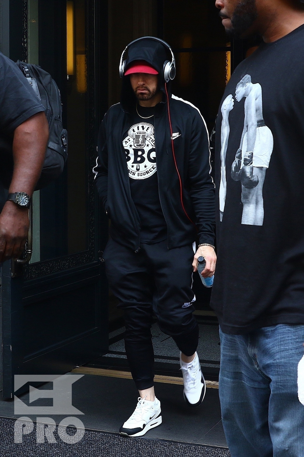 New York, NY - *EXCLUSIVE* - Eminem quickly heads to his car after leaving his hotel. Eminem doesn't have the time to stop and talk to fans as he waves instead and hops into his ride.