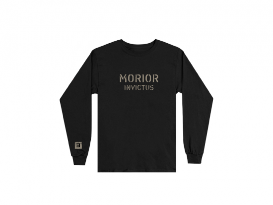 "This is a pre-order and is expected to ship in 4-5 weeks.   Exclusive and limited Kamikaze merchandise.  Morior Invictus (Latin for ""Death Before Defeat"") printed in sandstone on front chest center with E logo printed on right wrist of a black long sleeve shirt."