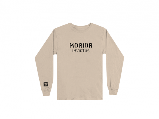 "This is a pre-order and is expected to ship in 4-5 weeks.   Exclusive and limited Kamikaze merchandise.  Morior Invictus (Latin for ""Death Before Defeat"") printed in black on front chest center with E logo printed on right wrist of a sandstone long sleeve shirt."